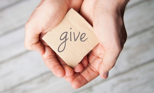 Phrasal verb with give